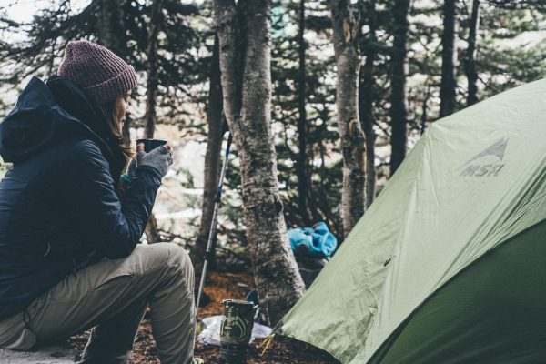 Lady camping in woods