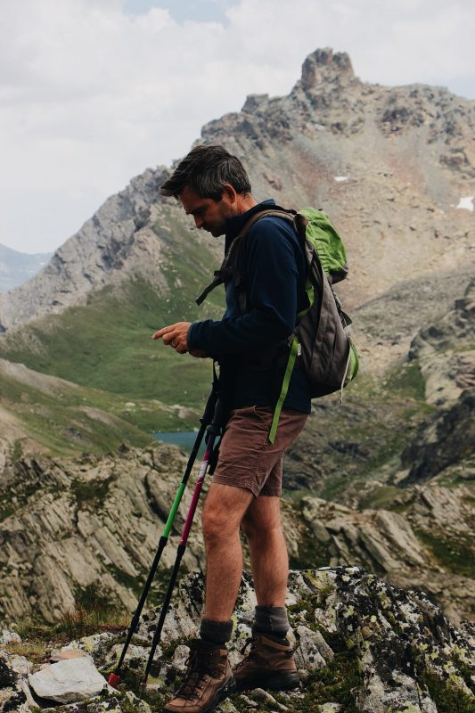 man with two hiking sticks