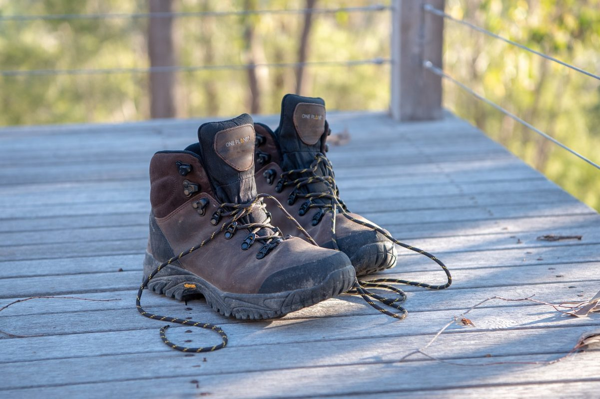 a pair of brown hiking boots