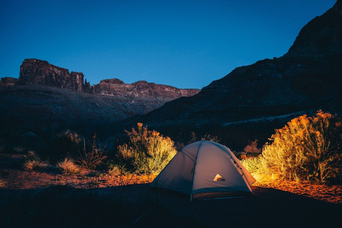 camping in a tent in a remote place
