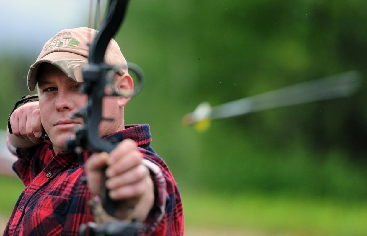 man participating in archery