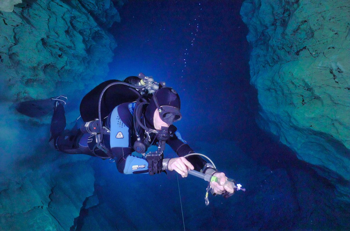 person cave diving