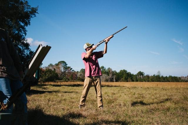 man with hunting gun